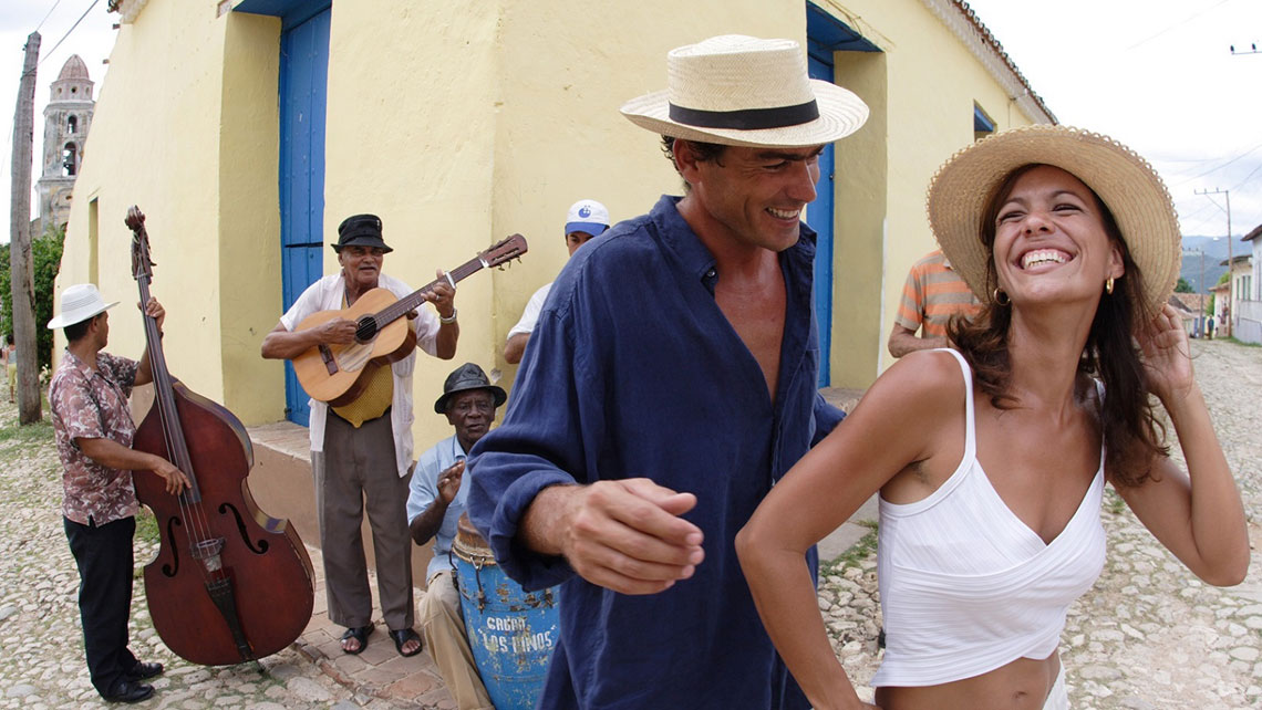 A young couple dancing on a street in Trinidad