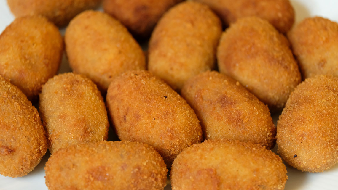 A dish of Cuban Croquetas