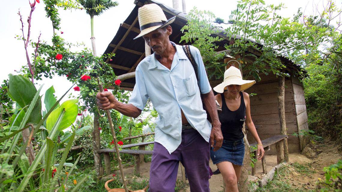 A tourist following a local in Baracoa
