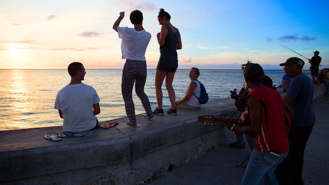 People dancing on the seawall in Havana