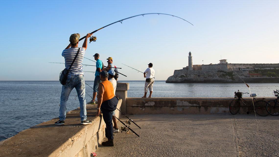 Fishermen on Havana seawall