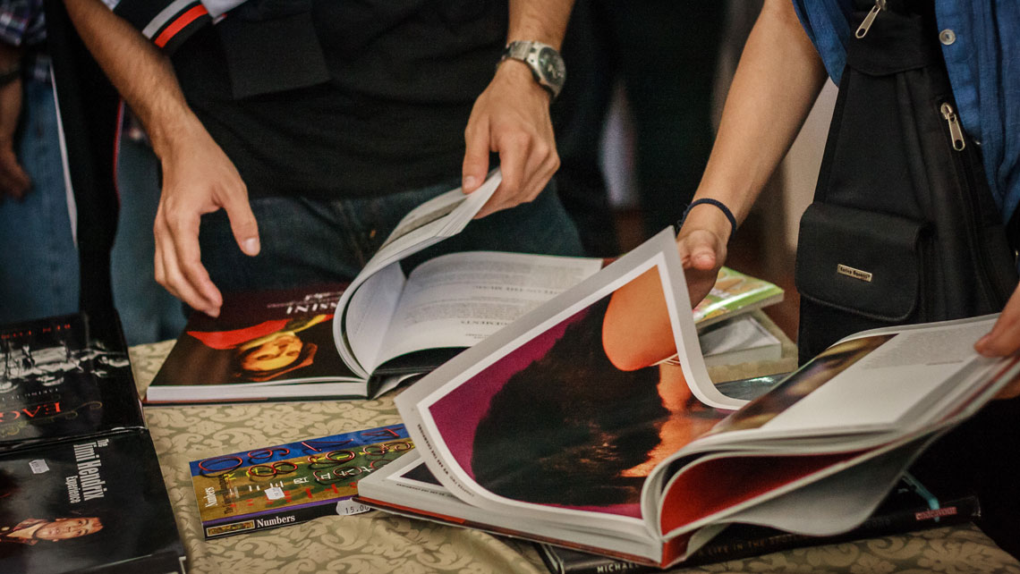 People checking a selection of books during the International Book Fair in Havana