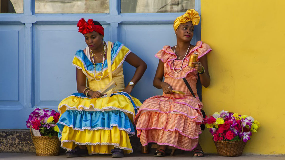 Cuban women wearing traditional dress in Havana Vieja
