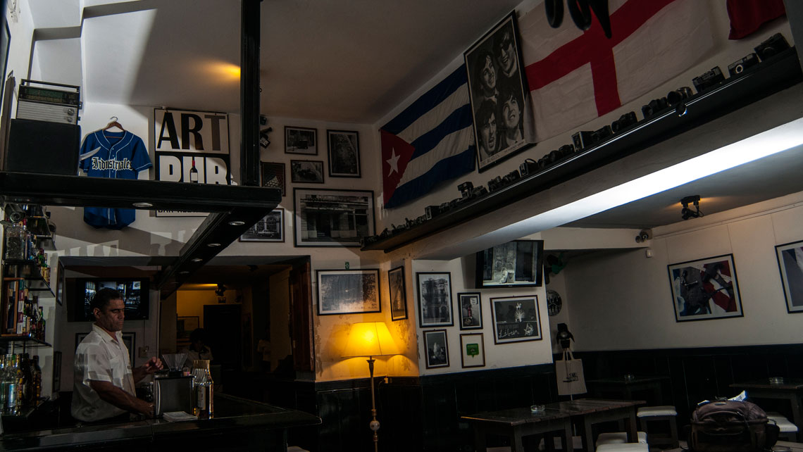 Cuban photography and international memorabilia on the walls of Art Pub