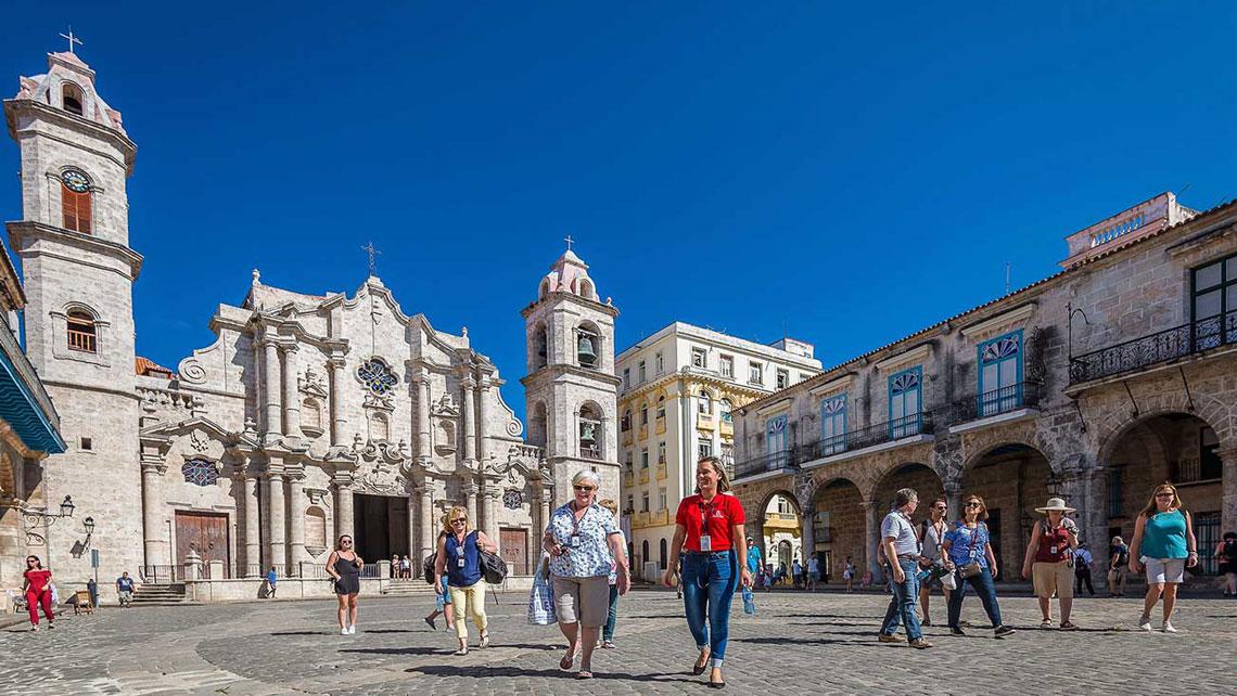 People walking in Catedral Square, Old Havana