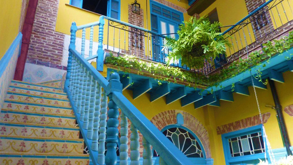 Colourful staircase with decorative plants in a Casa Particular