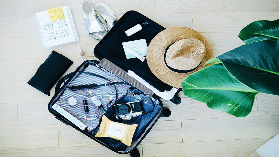 Suitcase packed with holiday essentials