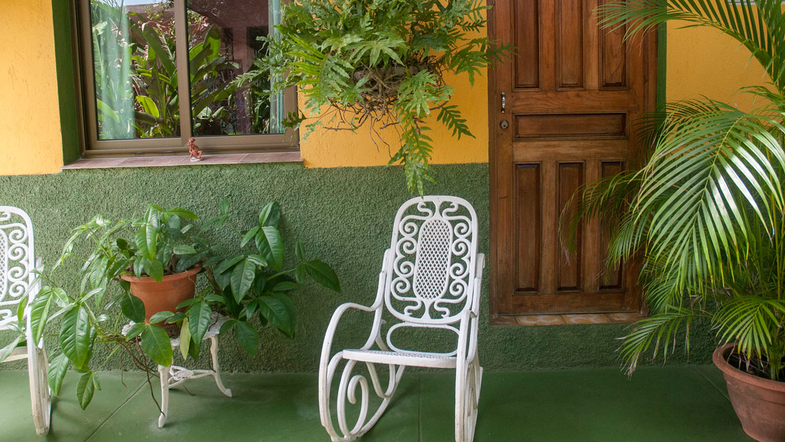 Rocking chairs in a cosy patio of a Casa Particular
