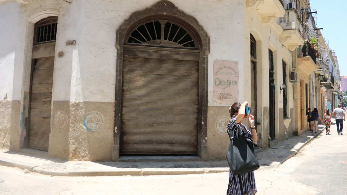 A young woman taking pictures in Havana