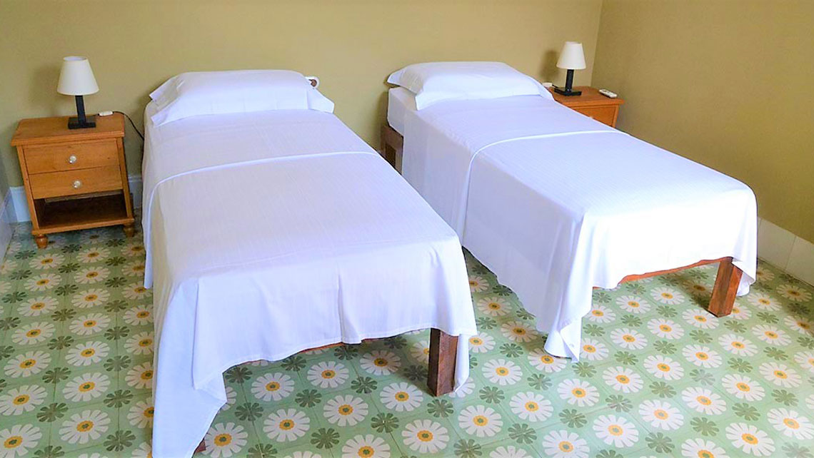 Twin beds in Hostal Mi Tierra