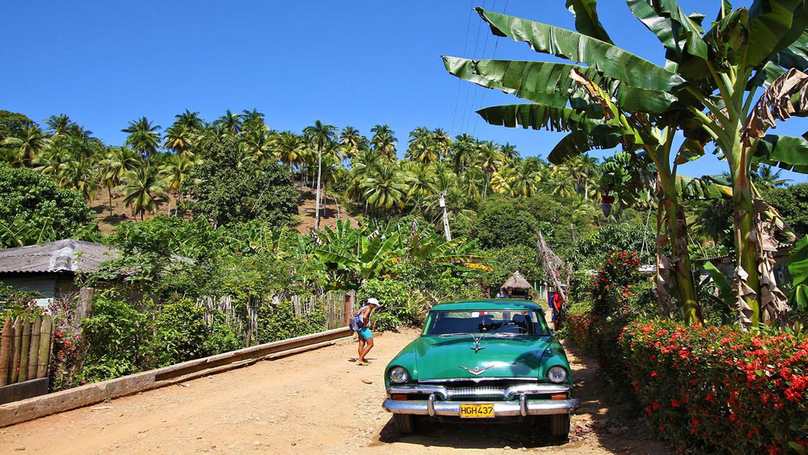 Vintage american car in a dirty road of Baracoa