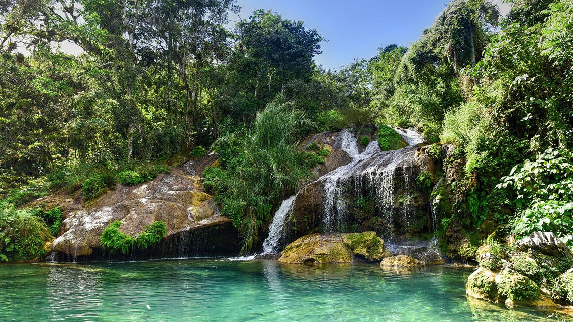 Jade-green waters of El Nicho waterfalls