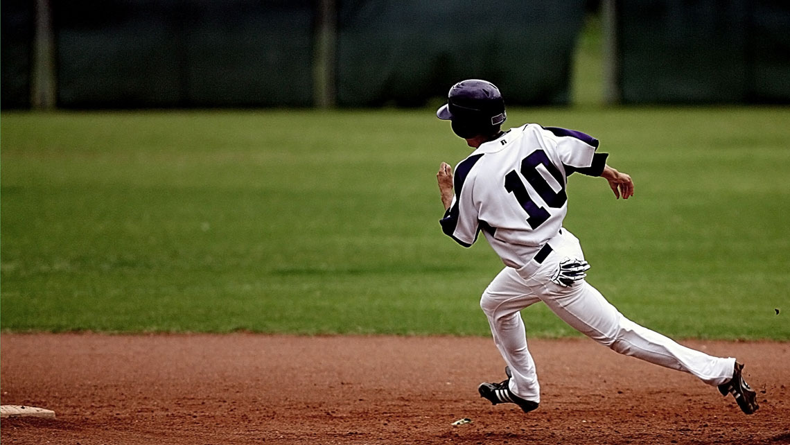 A baseball player running in the pitch