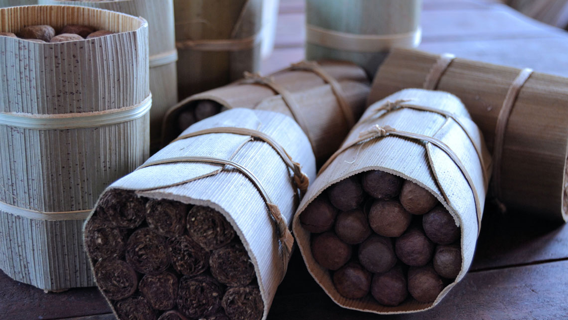 Bunches of Cuban cigars wrapped with rustic materials