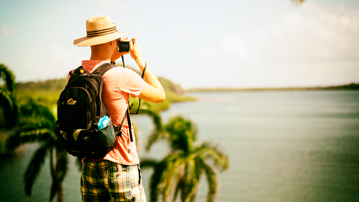 A man taking pictures in Alejandro de Humboldt National Park
