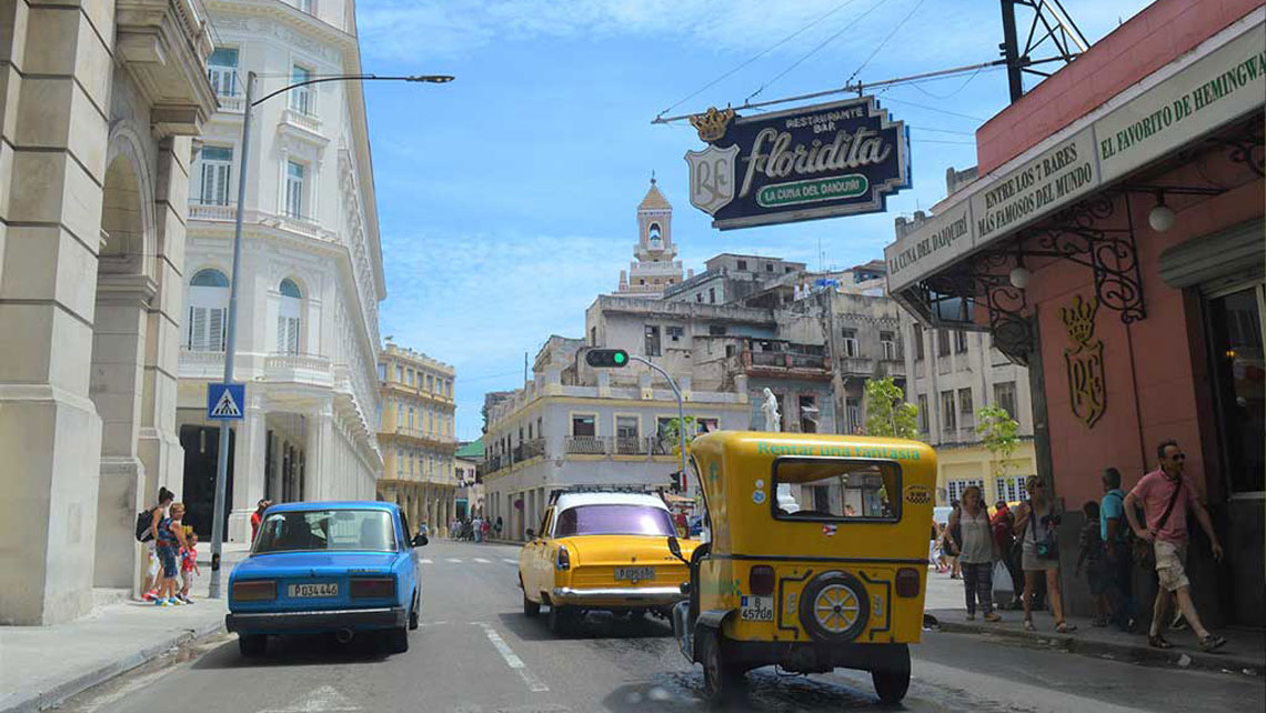 Vehicles passing near the famous bar El Floridita