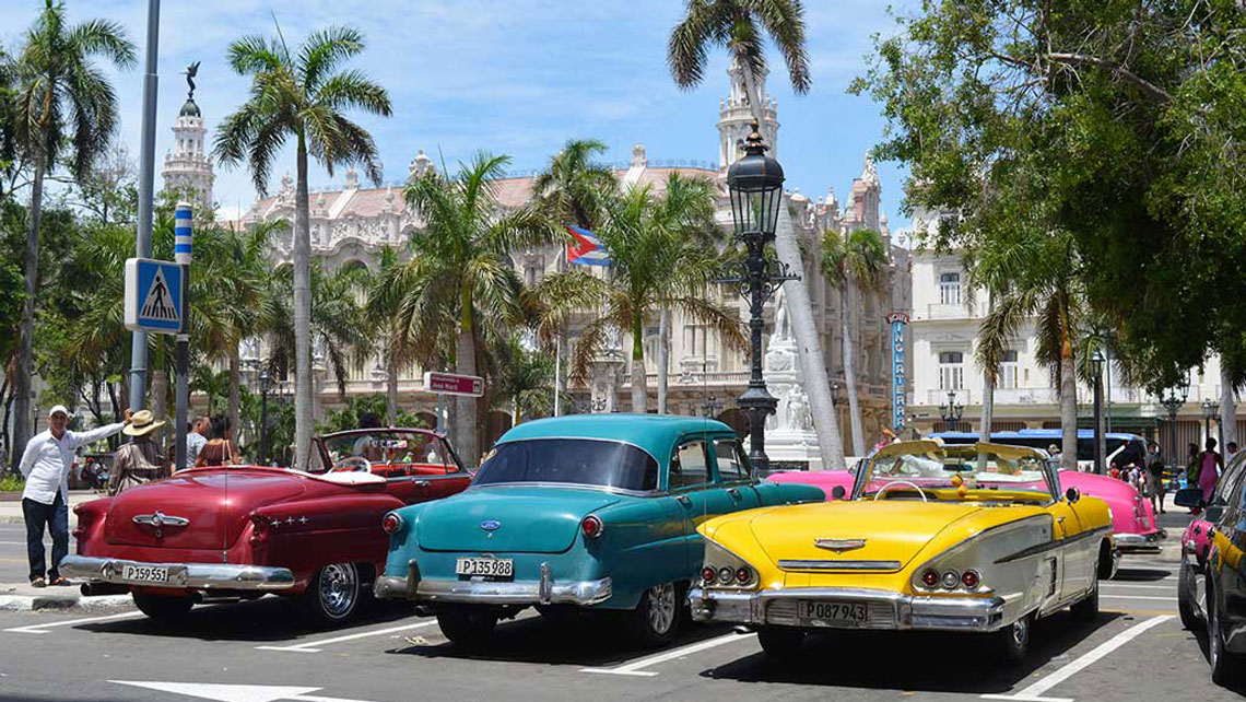 Classic American cars in a parking lot in Parque Central, Old Havana