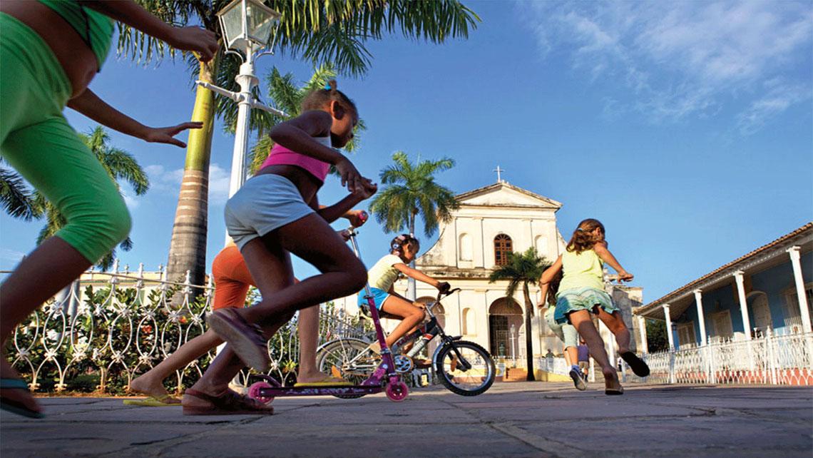 Children playing in Plaza Mayor, Trinidad