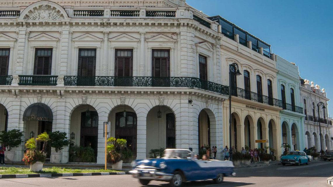 A vintage convertible american car cruising a street in Havana