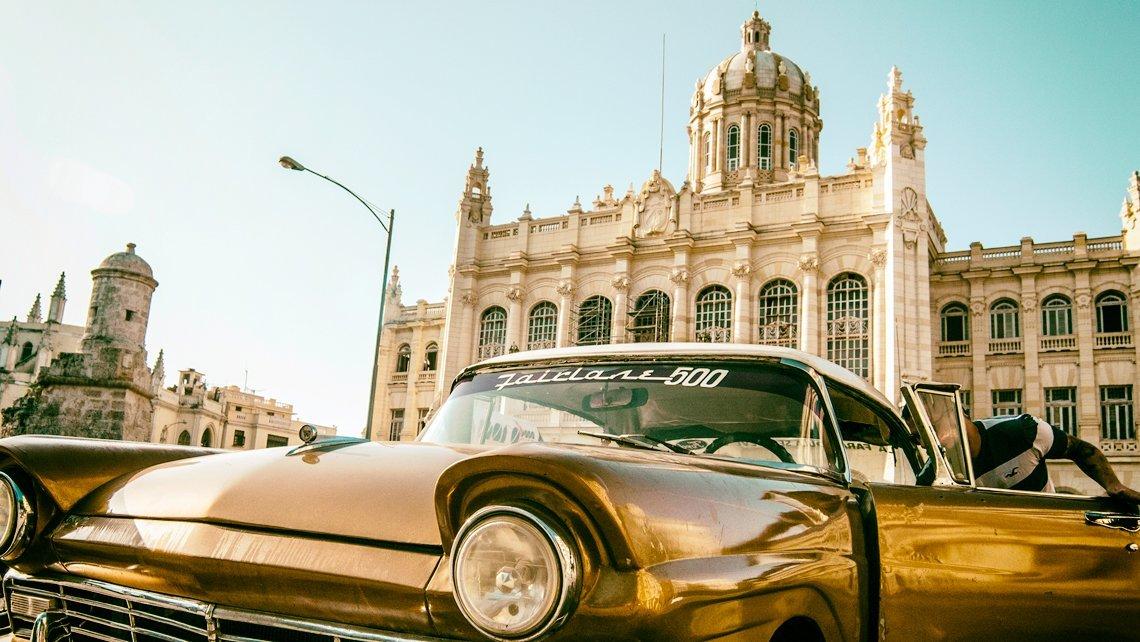 A vintage american car in front of Museo de la Revolucion in Havana