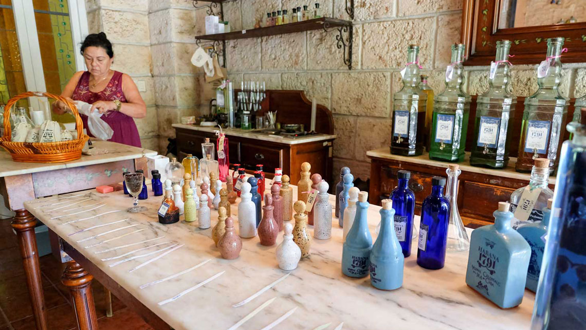 A woman packing handmade soaps in boutique like perfume shop in Old Havana