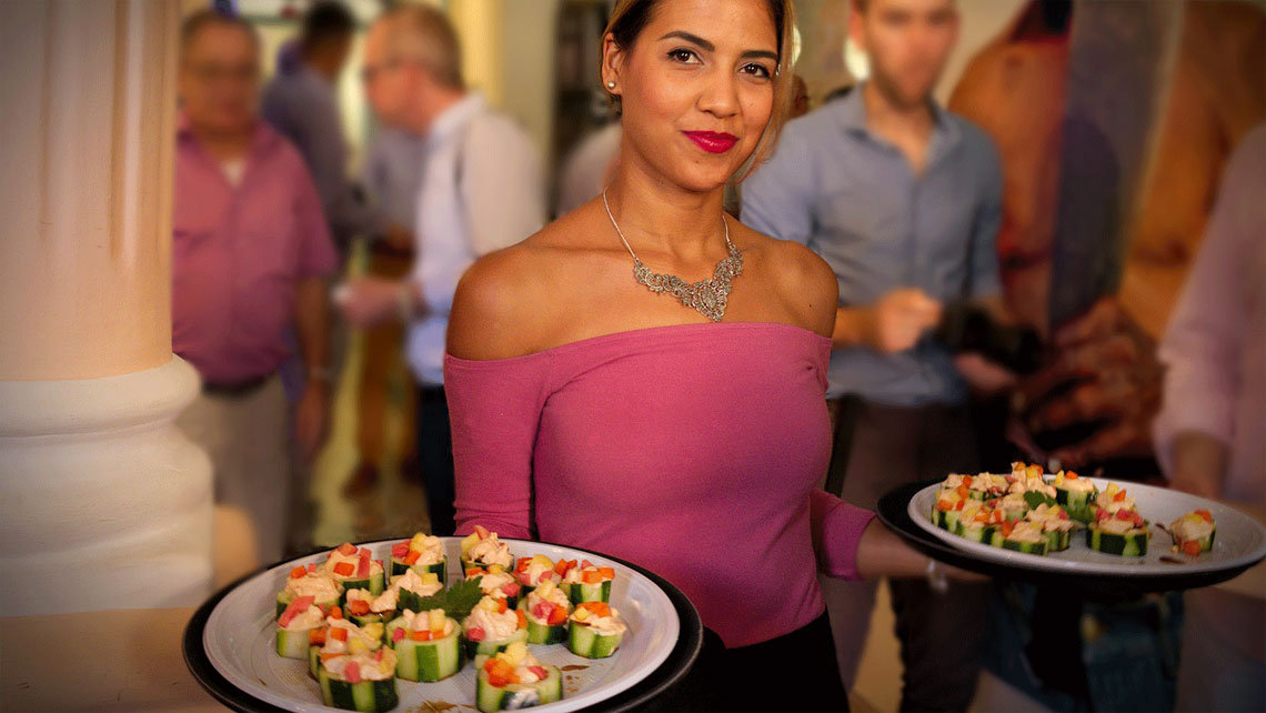 Young woman holding two plates with aperitives