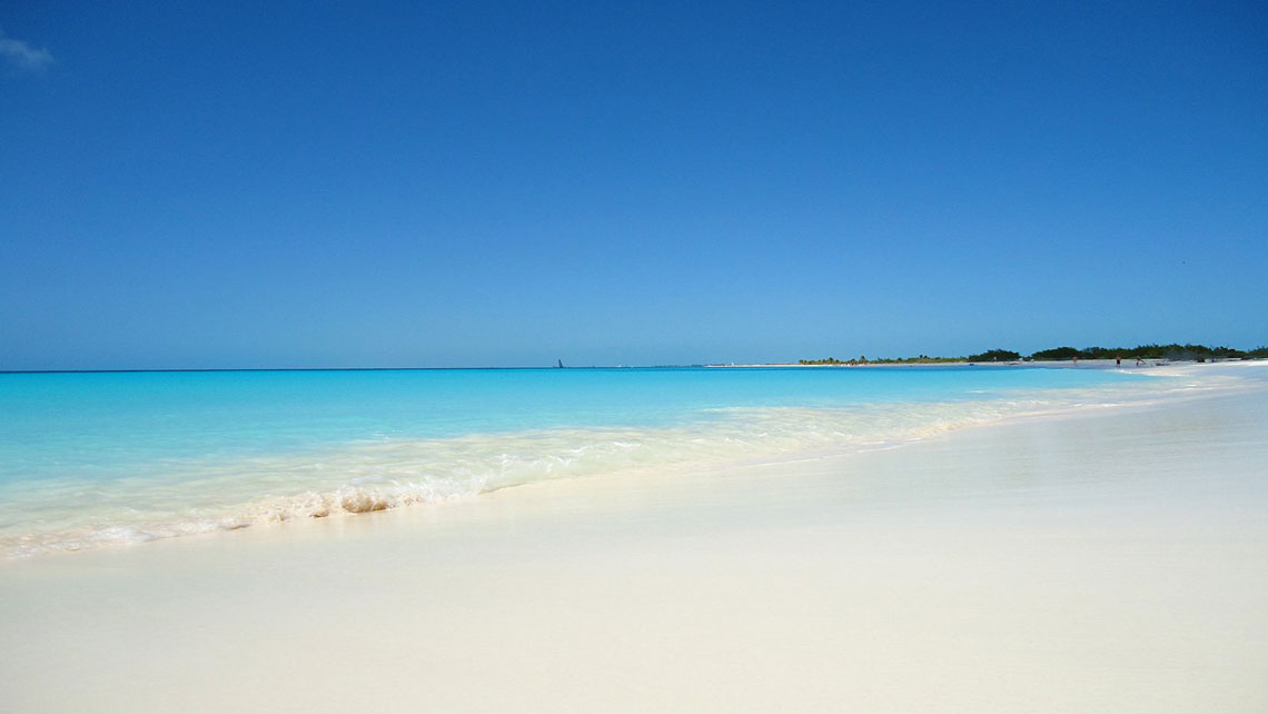 White sands and clear waters of Playa Cazonal in Santiago de Cuba