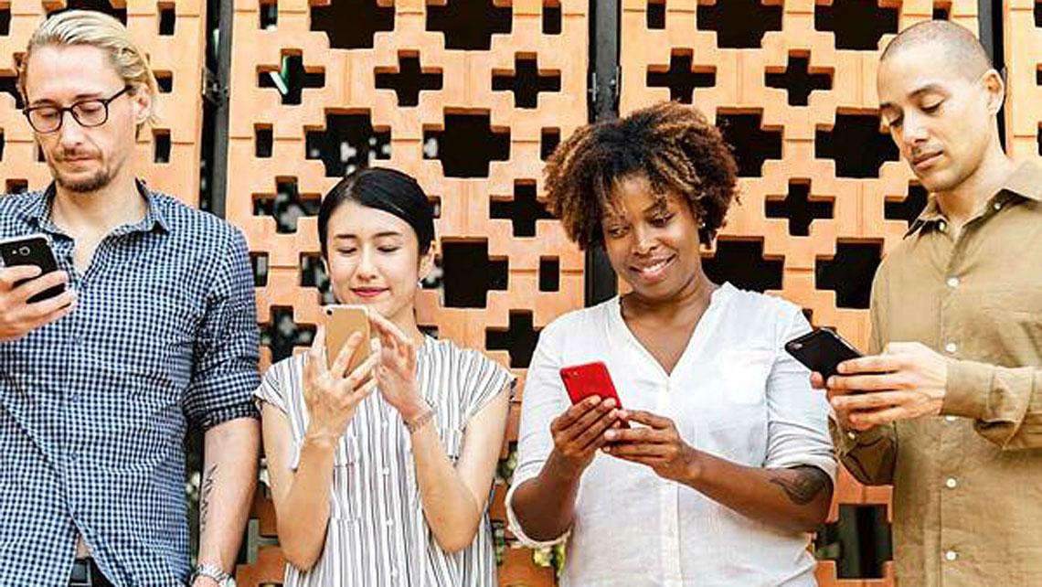 People looking at their mobile phones