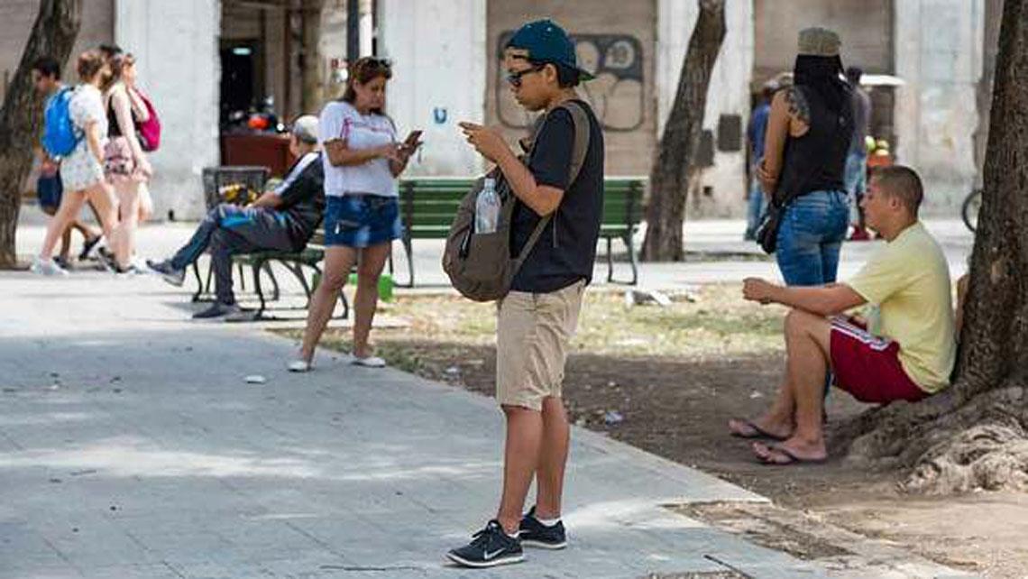 Cubans using internet in a wifi zone