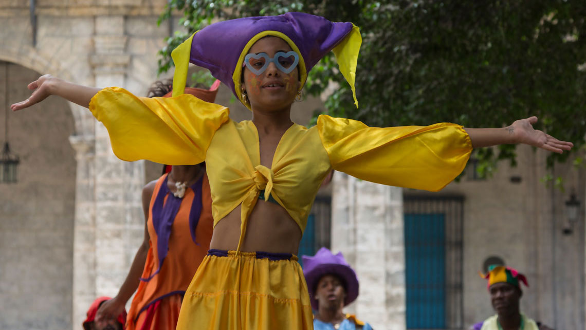 Colourful street performers adorn the cobbled alleys of Old Havana with their drumming and dancing