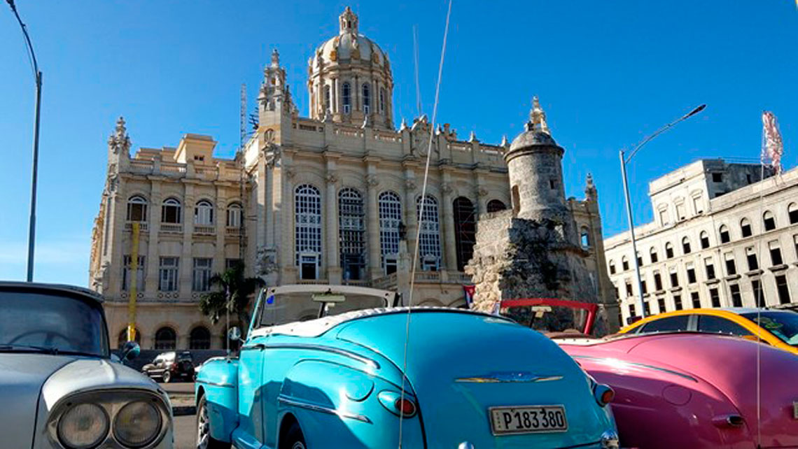 Vintage american cars parked in front of Museo de la Revolucion in Havana