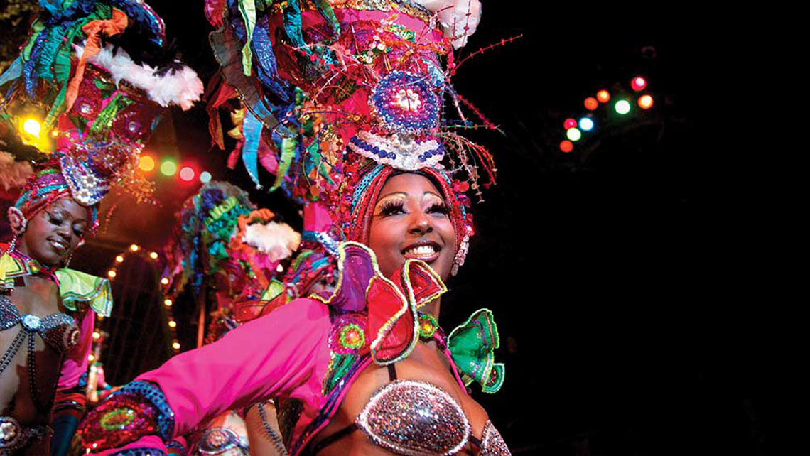 A carnaval dancer wearing colourful accessories