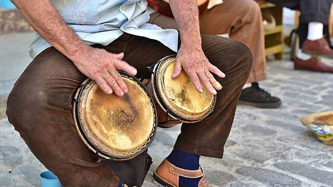 Close-up of man's hands playing Cuban's rhythms