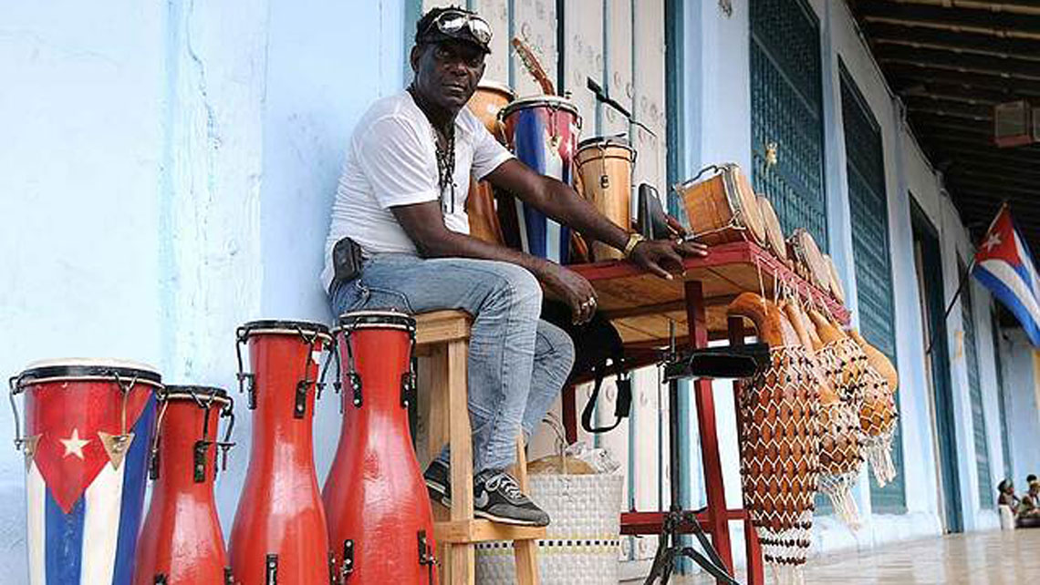 Man selling percurssion instruments in Cuba