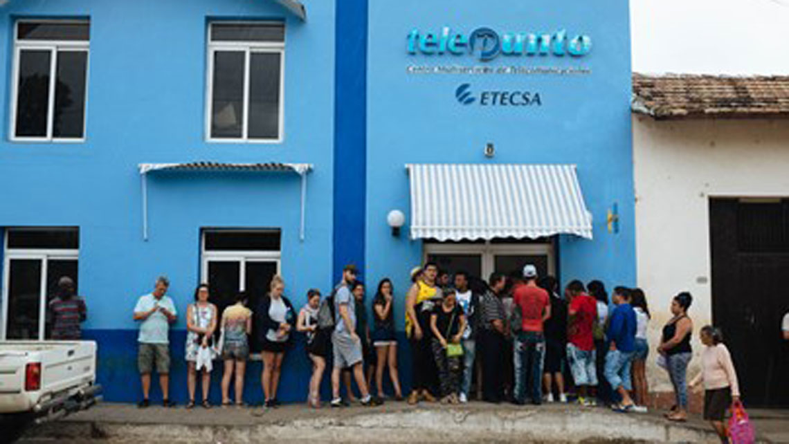 People queing in front of one shop of ETECSA (the Cuban telecommunications company)to buy WiFi card