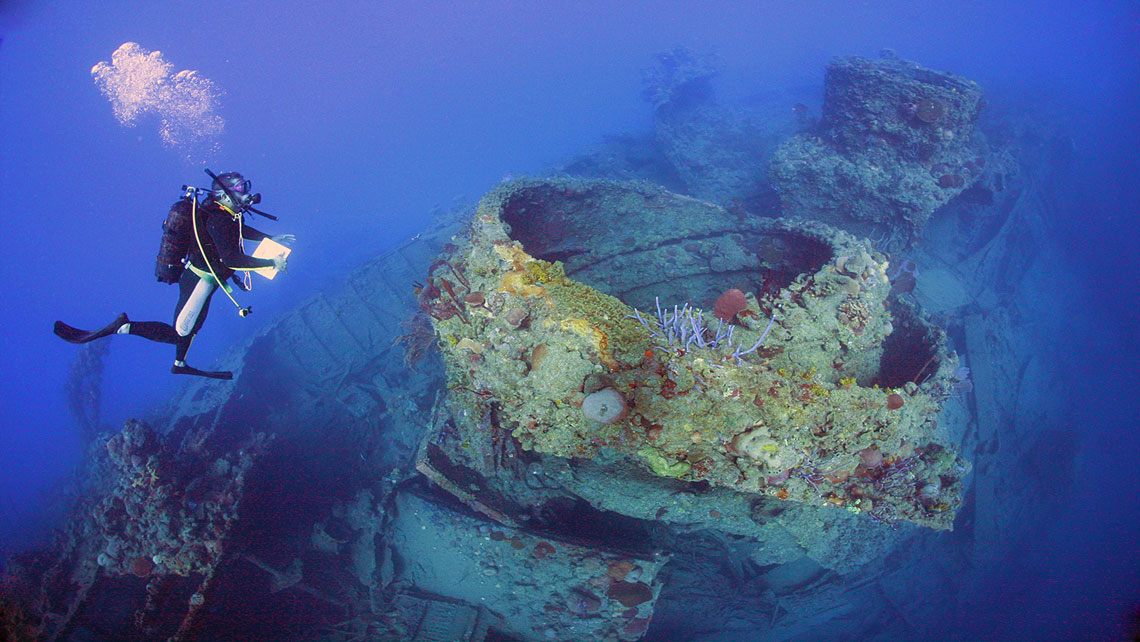 A scuba diver near ship-wreck of El Jaruco