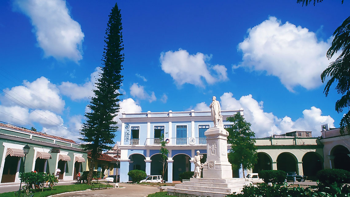 Elegant Hotel del Rijo viewed from Honorato del Castillo Park in Sancti Spiritus