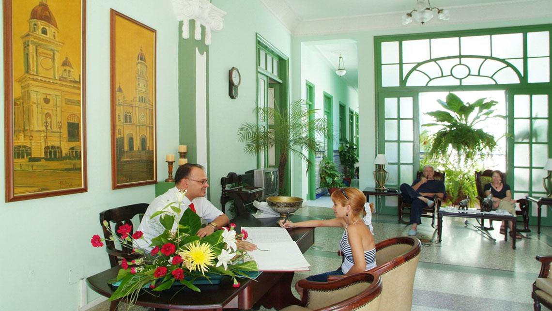Elegant interiors with large windows in Hotel San Basilio, Santiago de Cuba