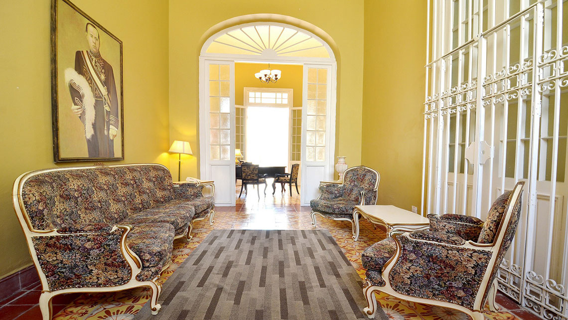 Colonial-style wooden furniture and elegant decoration in Hotel El Marqués, Camaguey