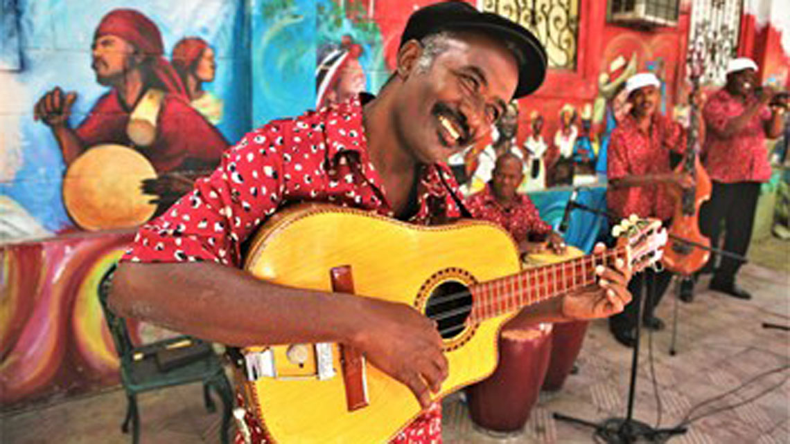 A local playing the Cuban Tres guitar