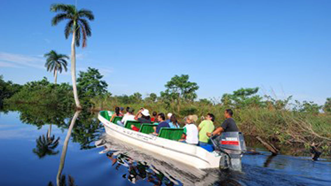 A group of tourist during a guide tour in a boat