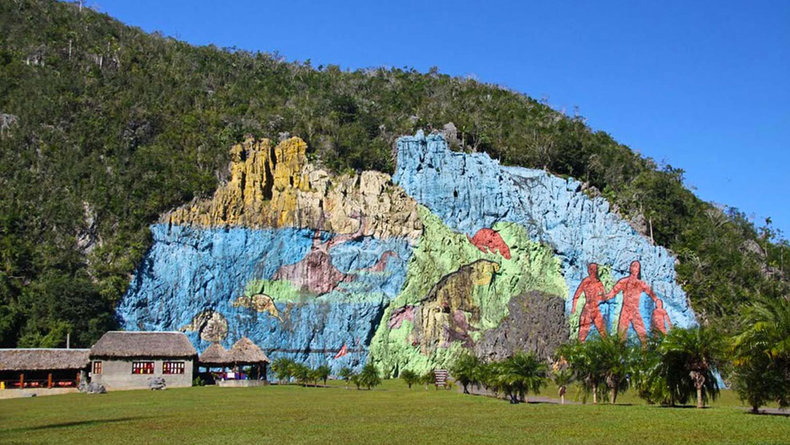 Mural of Prehistory is an impressive painting on the side of a mountain