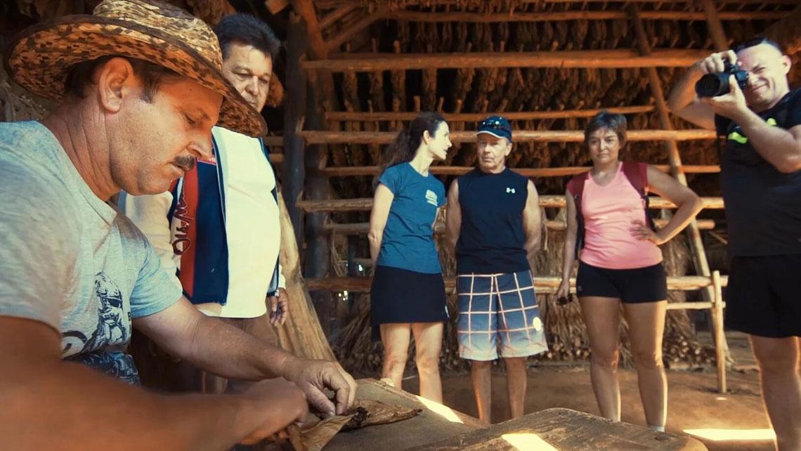 A Cuban tobacco farmer hand-rolling cigars