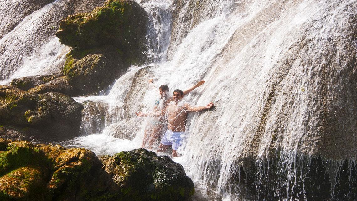 Young men bathing in Nicho waterfall