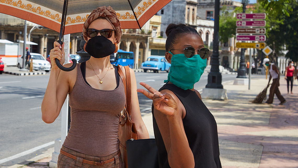 Two people wearing face masks in Havana