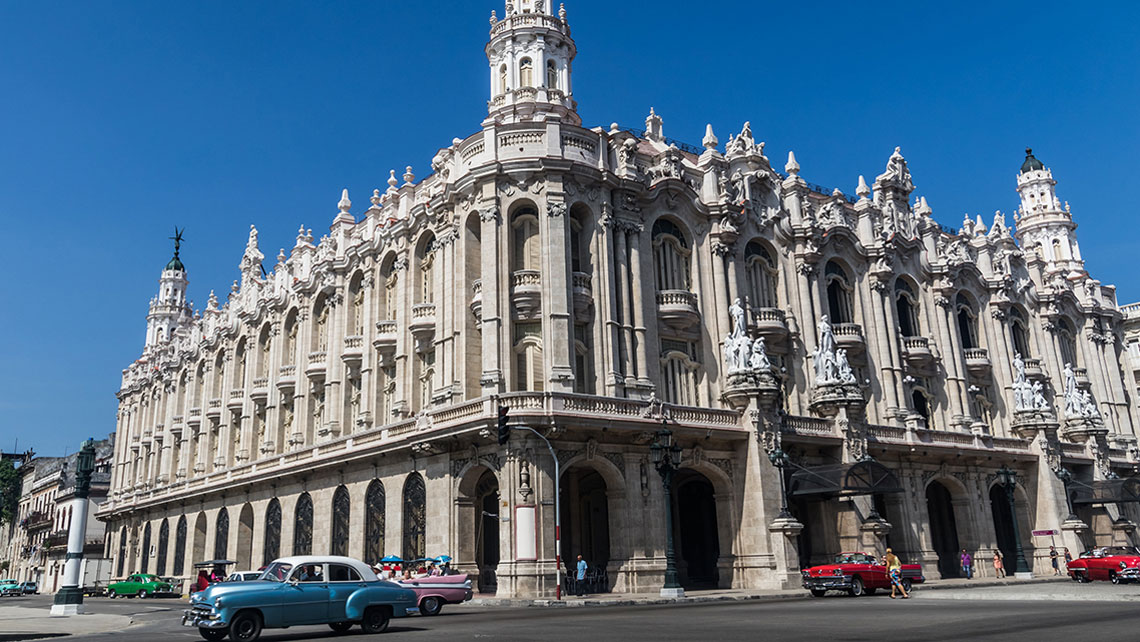 Old vintage car passing by Grand Theatre of Havana Alicia Alonso