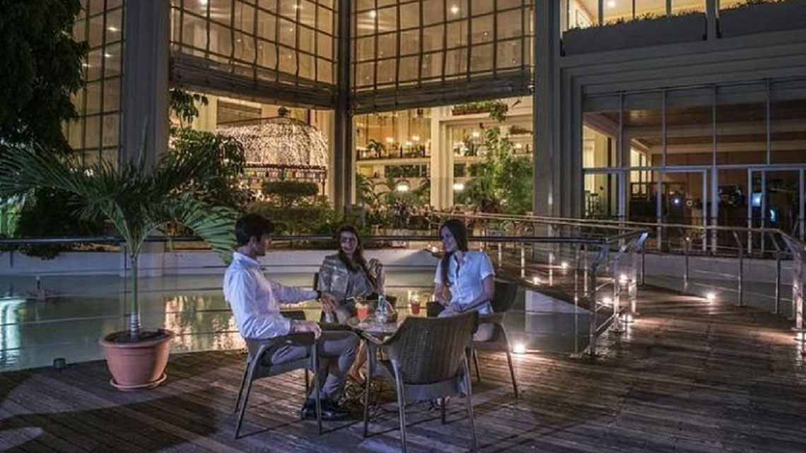 People seating in an open space in Hotel Blau Varadero