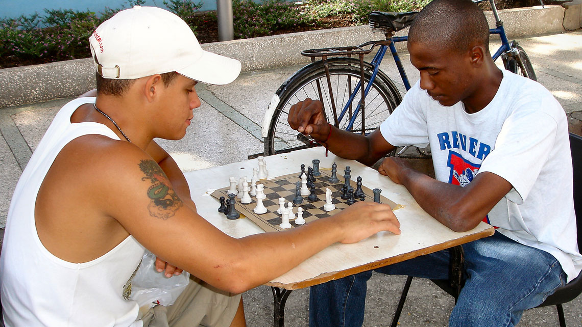 Two young men playing chess in Havana