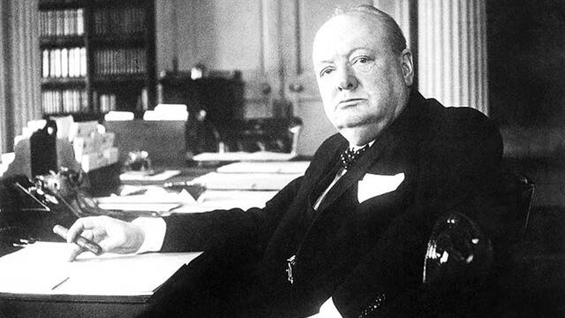 Winston Churchill as British Prime Minister at his desk holding a cigar