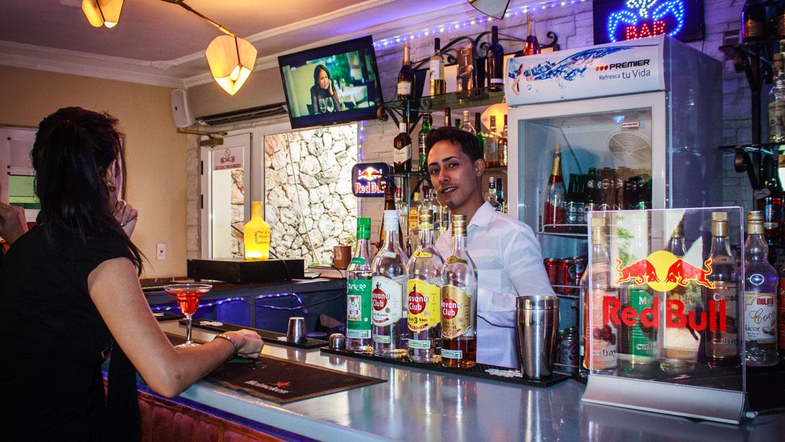 Bartender by the drink counter in La Romana, Cuba